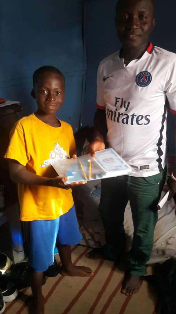 Learning kits are handed out to all the boys in the team