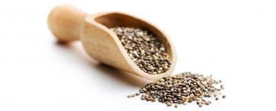 Chia seeds in a wooden scoop