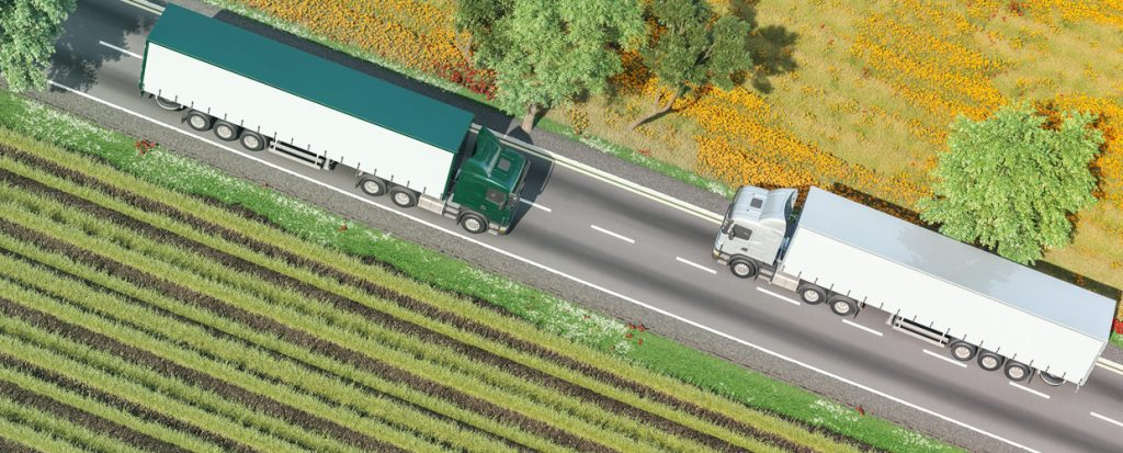 Two trucks passing on a country road