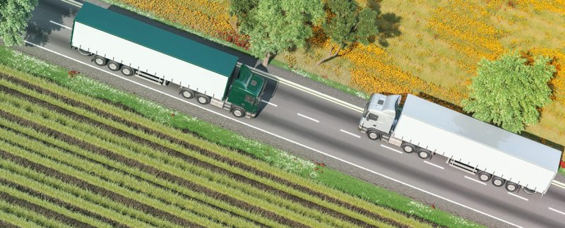 two trucks passing on a road